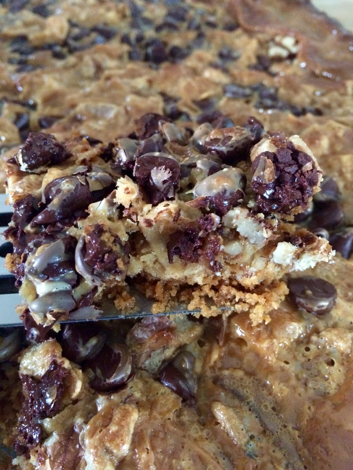 Hello Dolly Seven Layer Magic Cookie bar recipe. Easy sweet gooey chocolate coconut