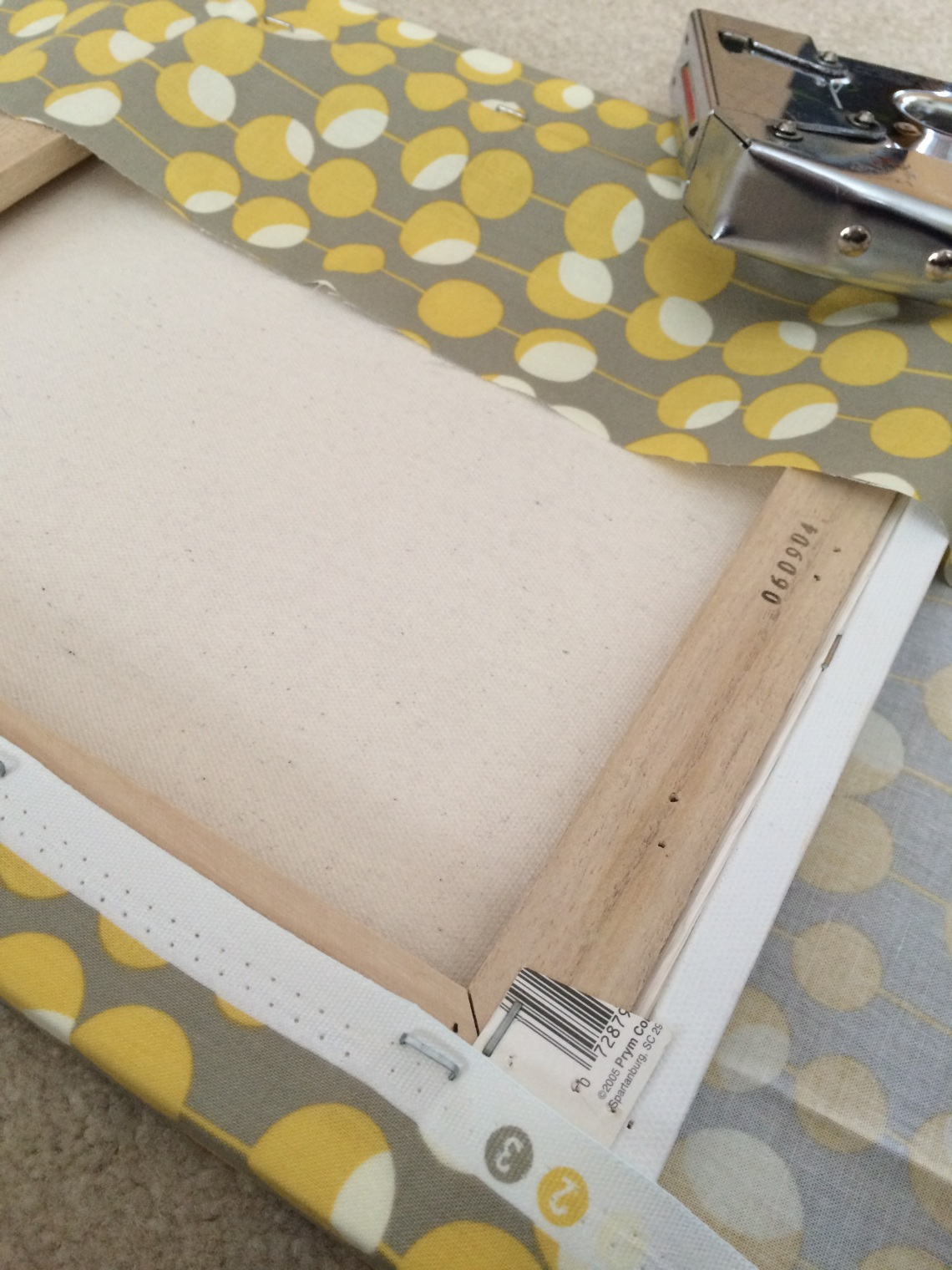 staple fabric canvas frame yellow grey